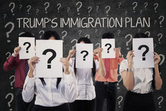 Business people with question marks and Trump`s plan Stock Photography