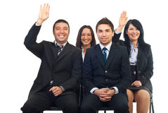 Business people raise hands. Business people at course or auction raise hands  and laughing Stock Images