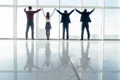 Free Business People Raised Hands Together In Office Team Satisfied With Result, Won Profitable Contract, Group Of Winners Celebrate Vi Stock Images - 107918014