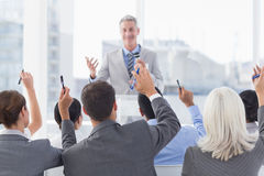 Business people raising their arms during meeting Stock Images