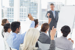 Business people raising their arms during meeting Royalty Free Stock Photo