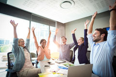 Business people raising their arms Stock Image