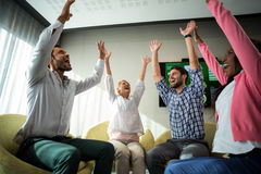 Business people raising their arms Royalty Free Stock Photo