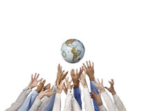 Business people reaching for the world Royalty Free Stock Photos