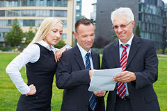 Business people reading contract Royalty Free Stock Image