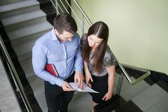 Business people reading a document together Royalty Free Stock Photo