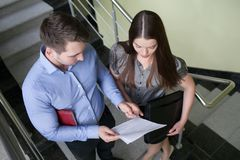 Business people reading a document together Stock Photos