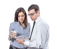 Business people reading documents in a tablet Stock Images
