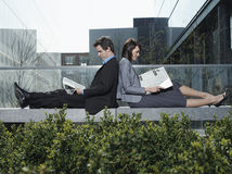 Business People Reading Newspapers On Wall Stock Photos