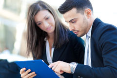 Business People reading some documents. Two business people reading some documents royalty free stock images