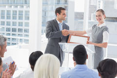 Business people receiving award Stock Image