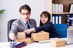 The business people receiving new mail and parcels. Business people receiving new mail and parcels royalty free stock images