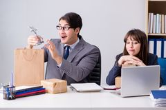 The business people receiving new mail and parcels. Business people receiving new mail and parcels Royalty Free Stock Photos