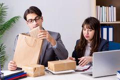 The business people receiving new mail and parcels. Business people receiving new mail and parcels Royalty Free Stock Photography