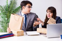 The business people receiving new mail and parcels. Business people receiving new mail and parcels Royalty Free Stock Photo