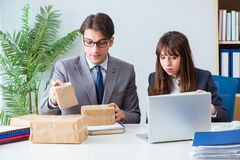 The business people receiving new mail and parcels. Business people receiving new mail and parcels Stock Photography