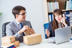 The business people receiving new mail and parcels. Business people receiving new mail and parcels Stock Photos