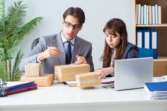 The business people receiving new mail and parcels. Business people receiving new mail and parcels stock photo