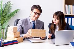 The business people receiving new mail and parcels. Business people receiving new mail and parcels stock images
