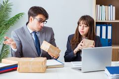 The business people receiving new mail and parcels. Business people receiving new mail and parcels stock image