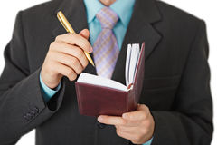 Business people record information in a notebook Royalty Free Stock Images