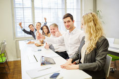 Business people rejoice and hold thumbs up Stock Photos
