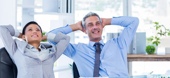 Business people relaxing in swivel chair Stock Photos