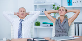 Business people relaxing in swivel chairs Royalty Free Stock Photos