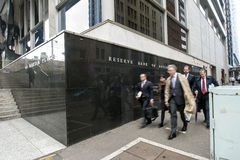 Business people Reserve Bank Building. A group of Business people hurrying by the Reserve Bank Building Sydney on a winters morning stock image