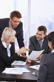 Business people reviewing contract Stock Photos