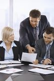 Business people reviewing documents Royalty Free Stock Image