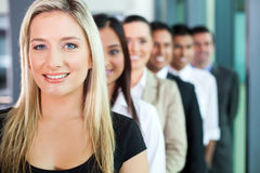 Business people row. Happy group of business people in a row stock photos