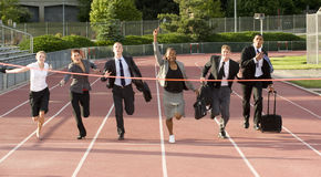 Business People Running Across the Finish Line Stock Photos