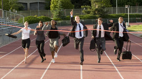 Business People Running Across the Finish Line Royalty Free Stock Photography