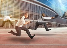 Business men working at full speed in a race track Royalty Free Stock Photos