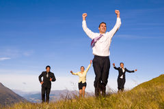 Business People Running on the Mountain Stock Images