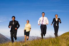 Business People Running on the Mountains Royalty Free Stock Photo