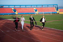 Business people running on racing track Stock Image