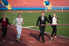 Business people running on racing track Stock Photo