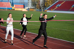Business people running on racing track Royalty Free Stock Photography