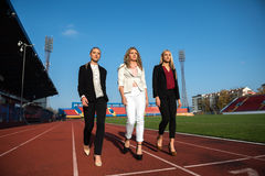 Business people running on racing track Stock Images