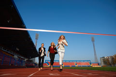 Business people running on racing track Royalty Free Stock Photos