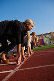 Business people running on racing track Stock Photography