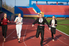 Business people running on racing track Stock Photos