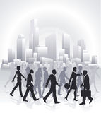 Business people rushing in front of city skyline Stock Images
