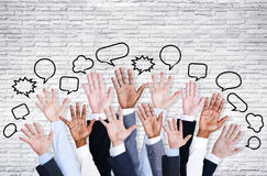 Business people's Arms Raised with Speech Bubble Stock Photography