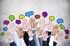 Business people's Arms Raised with Speech Bubble. By concrete wall Stock Photo
