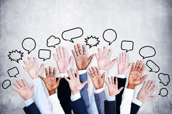 Business people's Arms Raised with Speech Bubble Royalty Free Stock Photo