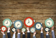 Business People's Hands  with Clock. Multiethnic Group of Business People with Time Concept Stock Photography