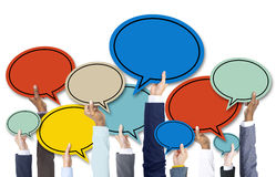 Business People's Hands Holding Colorful Speech Bubbles Royalty Free Stock Photography